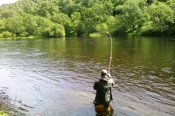 Euan Innes with a nice salmon on the Upper River Beauly